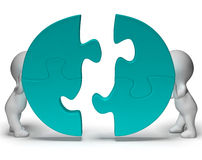 Jigsaw Pieces Being Joined Showing Teamwork And Togetherness. Jigsaw Pieces Being Joined Shows Teamwork And Togetherness Royalty Free Stock Photos