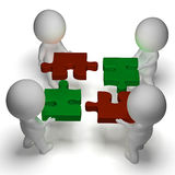 Jigsaw Pieces Being Joined Shows Teamwork And Assembling Royalty Free Stock Image