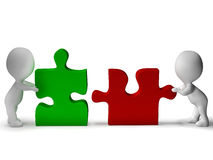 Jigsaw Pieces Being Joined Shows Teamwork And Collaboration Royalty Free Stock Images
