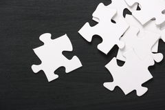 Jigsaw Pieces on a Blackboard Royalty Free Stock Photography