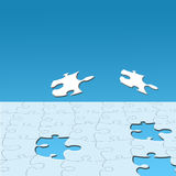 Jigsaw pieces on blue Stock Image
