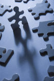 Jigsaw Pieces with Dramatic Light Royalty Free Stock Photo