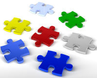 Jigsaw Pieces. Multi colored jigsaw pieces unlinked. 3D rendered reflective on white background Royalty Free Stock Photo