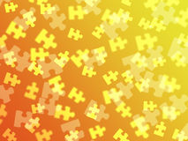 Jigsaw pieces on an orange gradient Stock Photos