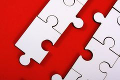Jigsaw pieces on red. Close up of jigsaw pieces on a red background Royalty Free Stock Photos
