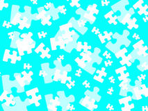 Jigsaw pieces on turquoise Royalty Free Stock Images