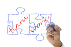Jigsaw Pieces written Team Work are drawn on board Royalty Free Stock Photo