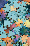 Jigsaw puzzle. Background from parts of puzzle. Pile of color mosaics Stock Photo