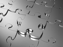 Jigsaw puzzle. Blank metal Jigsaw puzzle. 3D render royalty free illustration