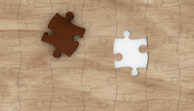 Jigsaw puzzle. One wooden puzzle with one piece in different color. the puzzle is incomplete (3d render stock illustration