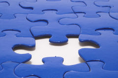 Jigsaw Puzzle. A close-up of a jigsaw puzzle with a missing puzzle piece stock photo