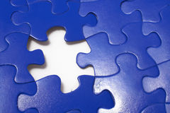Jigsaw Puzzle. A close-up of a jigsaw puzzle with a missing puzzle piece stock image