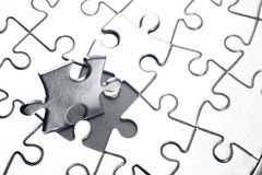 Jigsaw puzzle. Last piece of jigsaw puzzle Stock Photo
