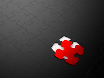 Jigsaw Puzzle. Black puzzle with a single red piece. Computer generated image Royalty Free Stock Image
