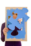 Jigsaw puzzle. Woman holding a jigsaw puzzle piece stock photography