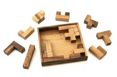 Jigsaw Puzzle. A wooden puzzle based on mathematical pentominoes Royalty Free Stock Images