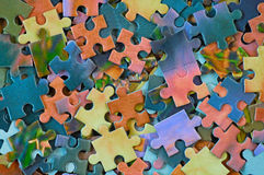 Jigsaw puzzle. Background from parts of puzzle. Pile color mosaics Stock Photos
