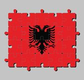 Jigsaw puzzle of Albania flag in a red field with the black double-headed eagle in the center. stock illustration
