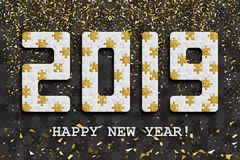 2019 jigsaw puzzle background with many golden glitter and black pieces. Happy New Year card design. Abstract mosaic stock photography