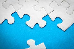 Jigsaw Puzzle. On Blue Surface Royalty Free Stock Photo