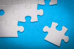 Jigsaw Puzzle. On Blue Surface Royalty Free Stock Image