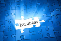 Jigsaw puzzle business. An image of a blue jigsaw puzzle with the word business Stock Image