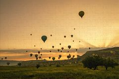 Jigsaw puzzle with Cappadocia hot air balloons.  Stock Photo