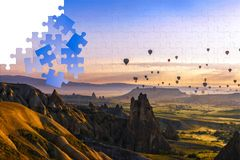 Jigsaw puzzle with Cappadocia hot air balloons.  Royalty Free Stock Photography