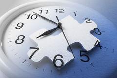 Jigsaw Puzzle and Clock. Composite of Jigsaw Puzzle and Clock Stock Photo