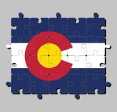 """Jigsaw puzzle of Colorado flag in blue white and blue. On top of these stripes sits a circular red """"C"""". stock illustration"""