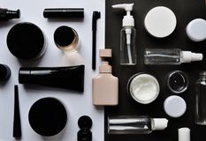 Jigsaw puzzle with cosmetics on white – black background Royalty Free Stock Image