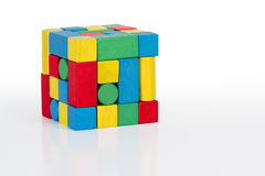 Jigsaw puzzle cube toy, multicolor wooden pieces, colorful game. Bricks over white background Stock Image