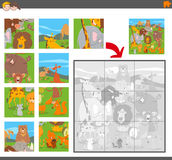 Jigsaw puzzle game with cartoon animals Royalty Free Stock Images