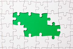 Jigsaw puzzle game piece on green background for business theme design stock image