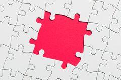 Jigsaw puzzle game piece on red background for business theme design. White jigsaw puzzle game pieces on red background form a banner for business theme design royalty free stock images