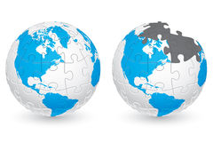 Jigsaw Puzzle Globe with America continents Stock Photo