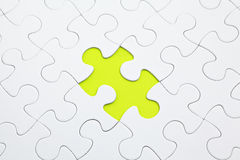 Jigsaw puzzle with green piece Stock Image