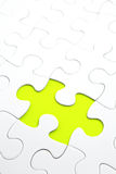 Jigsaw puzzle with green piece missed Stock Photos