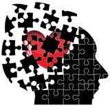 Jigsaw Puzzle head man with a heart shatters into Stock Images