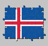 Jigsaw puzzle of Iceland flag in blue sky with a snow-white cross, and a fiery-red cross inside the white. stock illustration