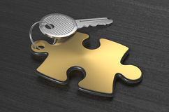 Jigsaw puzzle with a key Royalty Free Stock Images