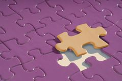 Jigsaw puzzle with the last piece going into place Royalty Free Stock Images