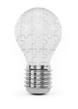 Jigsaw puzzle lightbulb Royalty Free Stock Photos