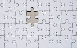 Jigsaw puzzle with one missing piece left to complete, copy space. Bottom view Royalty Free Stock Photos