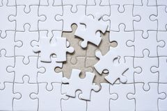 Jigsaw puzzle with one missing piece left to complete, copy space. Jigsaw puzzle with one missing piece l Stock Photos