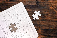 Jigsaw puzzle with one missing piece left to complete. Copy space, top view Royalty Free Stock Photography