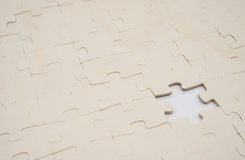 Jigsaw puzzle with one piece missed on white Stock Images