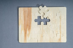 Jigsaw puzzle with one piece missing Royalty Free Stock Photos