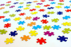 Jigsaw puzzle perspective. Lots of jigsaw puzzle pieces isolated on white Stock Image
