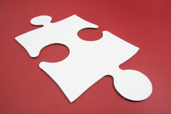 Jigsaw Puzzle Piece. On Red Background Royalty Free Stock Images